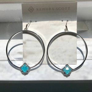 Kendra Scott sliver hoop earrings with blue stone